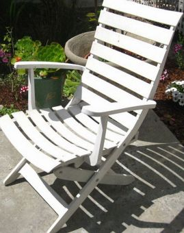 A painted and treated plastic outdoor chair